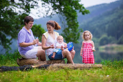 Young family with kids hiking at a lake Stock Photography