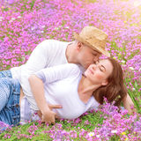 Young family kissing in the garden Stock Image