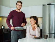 Young family on a kitchen Royalty Free Stock Photos
