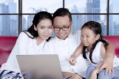 Young family with a laptop in the apartment Royalty Free Stock Photo