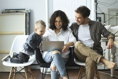 Young family with laptop royalty free stock images