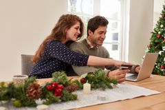 Couple doing online shopping for christmas Royalty Free Stock Photography