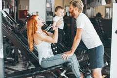 Young family with little boy in the gym stock photos