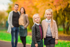 Young family with little kids in autumn park on sunny day Stock Photo