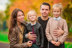 Young family with little kids in autumn park on sunny day Royalty Free Stock Photography