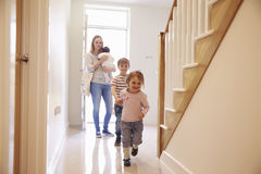Young Family Looking Around Property For Sale stock photography