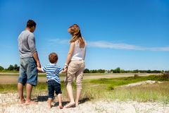 Young Family Looking at a Beautiful Landscape Royalty Free Stock Images
