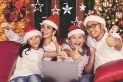 Young family with thumb up on Christmas day Royalty Free Stock Images