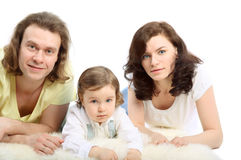 Young family are lying on white fluffy stock images