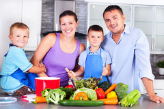 Young family making dinner together in the kitchen Stock Photo