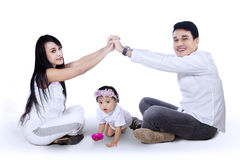 Young family making the home sign Stock Image