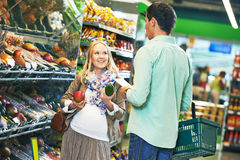 Young family man and woman shopping in store Royalty Free Stock Image