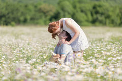 Young family on meadow Royalty Free Stock Photo