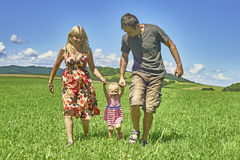 Young family on medow Stock Photo