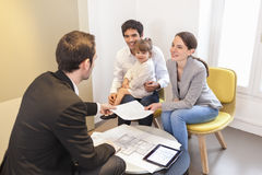 Young Family meeting real-estate agent to buy property Royalty Free Stock Image