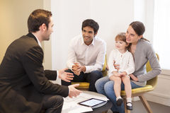 Young Family meeting real-estate agent to buy property Royalty Free Stock Photography