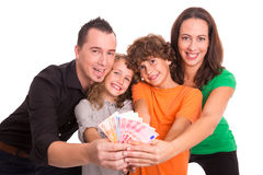 Young family with money in their hands. Family of four holding Euro banknotes in their hands Royalty Free Stock Photos