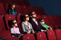 Young family in the movie theater Royalty Free Stock Photography
