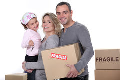 Young family moving house Stock Images