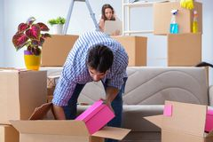 The young family moving to new apartment Stock Image