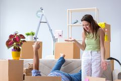 The young family moving to new apartment Stock Photos
