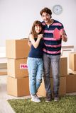 The young family moving to new house apartment. Young family moving to new house apartment stock photo