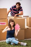 The young family moving to new house apartment. Young family moving to new house apartment stock photography