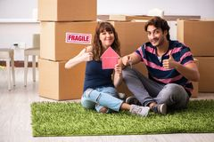 The young family moving to new house apartment. Young family moving to new house apartment royalty free stock image