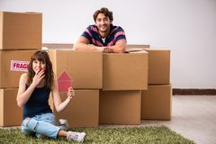 The young family moving to new house apartment. Young family moving to new house apartment royalty free stock photo