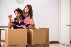 The young family moving to new house apartment. Young family moving to new house apartment stock photos
