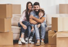Free Young Family Moving To New Place And Sits On Sofa. Stock Photography - 120842722