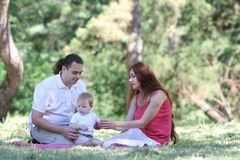 Young family on nature Royalty Free Stock Images