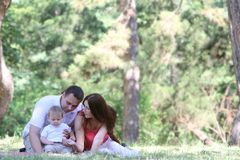 Young family on nature Royalty Free Stock Image