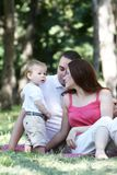 Young family on nature Royalty Free Stock Photo