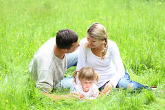 Young family on the nature Royalty Free Stock Photo