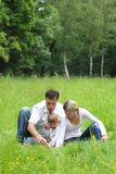 Young family on the nature Royalty Free Stock Images