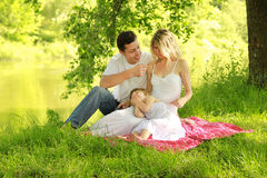 Young family on the nature Royalty Free Stock Image