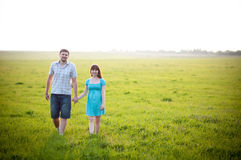 Young family on nature Stock Images