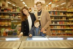 Young family near freezer Stock Photos
