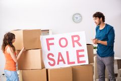 The young family offering house for sale and moving out. Young family offering house for sale and moving out stock images