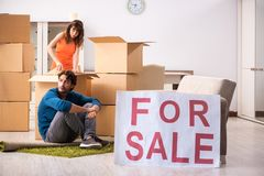 The young family offering house for sale and moving out. Young family offering house for sale and moving out royalty free stock image