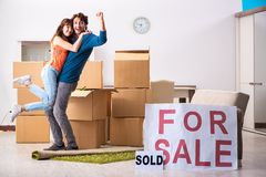 The young family offering house for sale and moving out. Young family offering house for sale and moving out stock image