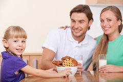 Young family with one child has breakfast Royalty Free Stock Photos