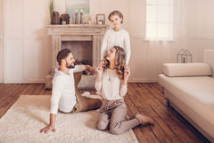 Young family with one child spending time together at home Stock Images