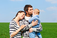 Young family at outdoors Royalty Free Stock Image