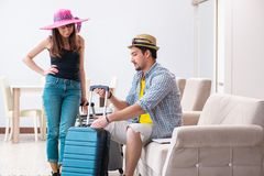 The young family packing for vacation travel stock photography