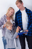 Young family painting new room Stock Photography