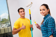 The young family painting the walls in diy concept Royalty Free Stock Images