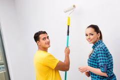 The young family painting the walls in diy concept Stock Image