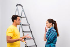 The young family painting the walls in diy concept Stock Photos
